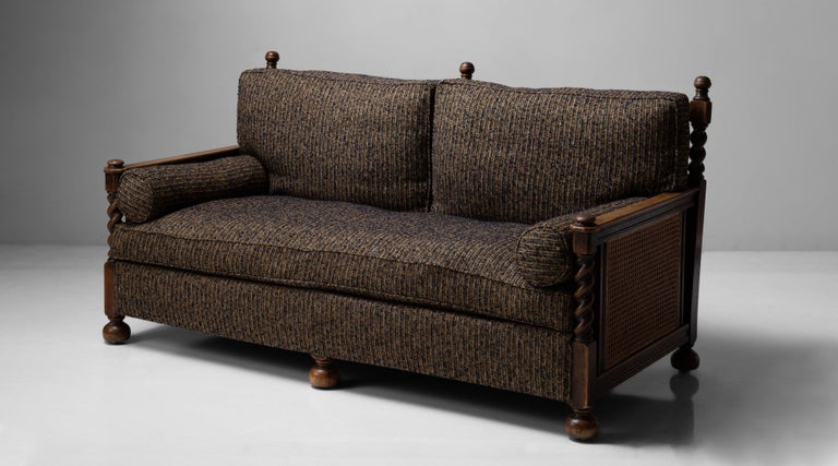 Newly upholstered cushions, oak and hardwood frame with spiral carving and cane sides and back.