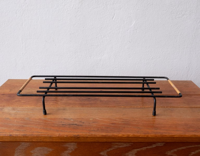 Midcentury cane wrapped rack by Laurids Lonborg. Great for a pot trivet in the kitchen or a small plant stand. Denmark, 1950s.