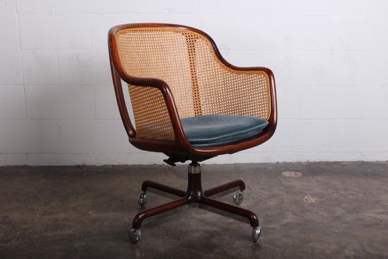 A fully caned desk chair with ash frame and original velvet seat. Designed by Ward Bennett for Brickel. Height is adjustable.
