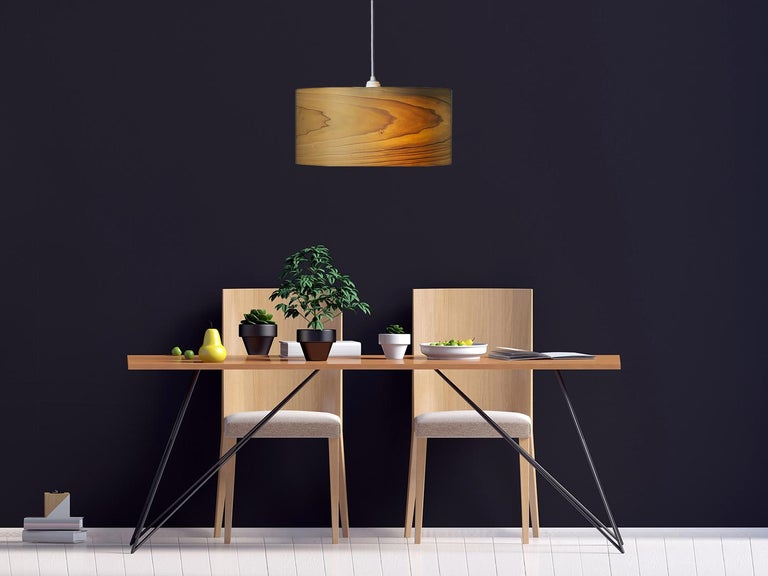 This large Poplar wood drum light, CANNEA, is a Mid-Century Modern style pendant. As a chandelier for alcove, entryway, dining room or conference room, CANNEA is offered in several custom wood types. CANNEA gives a warm light, complementing