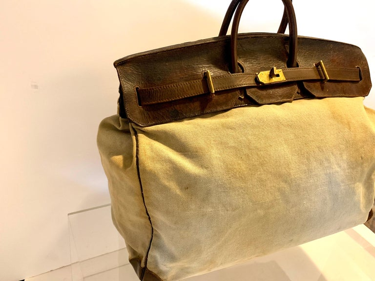 Rare giant, and amazing 50cm Hermes HAC (Haut À Courroies). We travel all over the world, and rarely find vintage HACs in well traveled condition like this. Definitely worn, but has a lot of life left. Corners are in good shape. Great size, and a