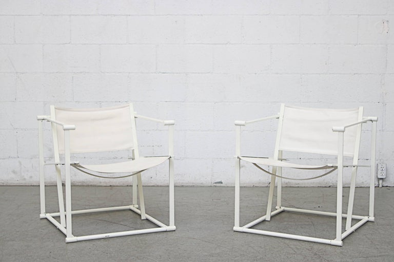 UMS Pastoe FM60, Cubic chair lounge chair, designed in 1980 by Radboud van Beekum. White enameled steel frame with original worn white-ish canvas seating. Visible wear with some fraying and fading of canvas. Frame are in original condition with