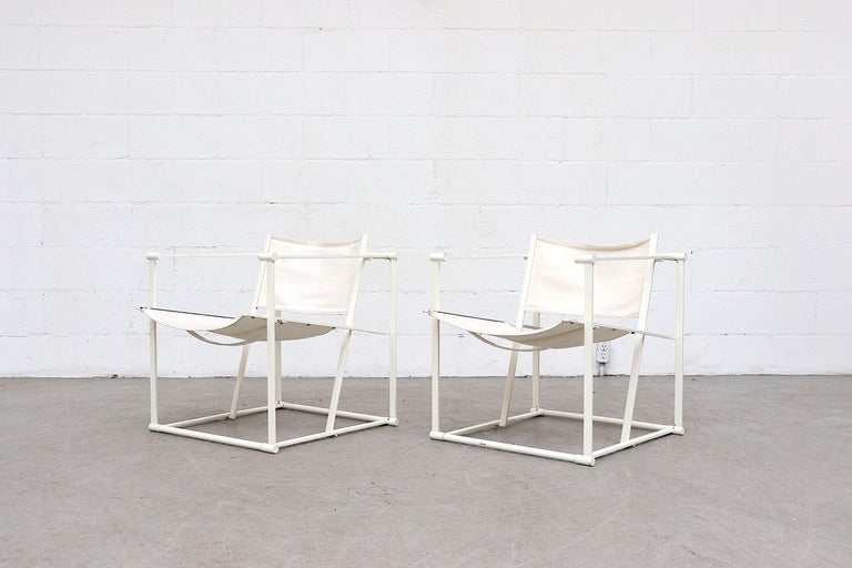 UMS Pastoe FM60, cube lounge chair, designed in 1980 by Radboud van Beekum. White enameled steel frame with original worn white-ish canvas seating. Frame is in original condition with visible wear to the enamel, visible fraying at seat and back