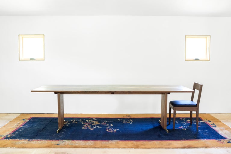 Turned Canyon Dining Table in Live Edge Walnut and Brass Inlay with Trestle Base