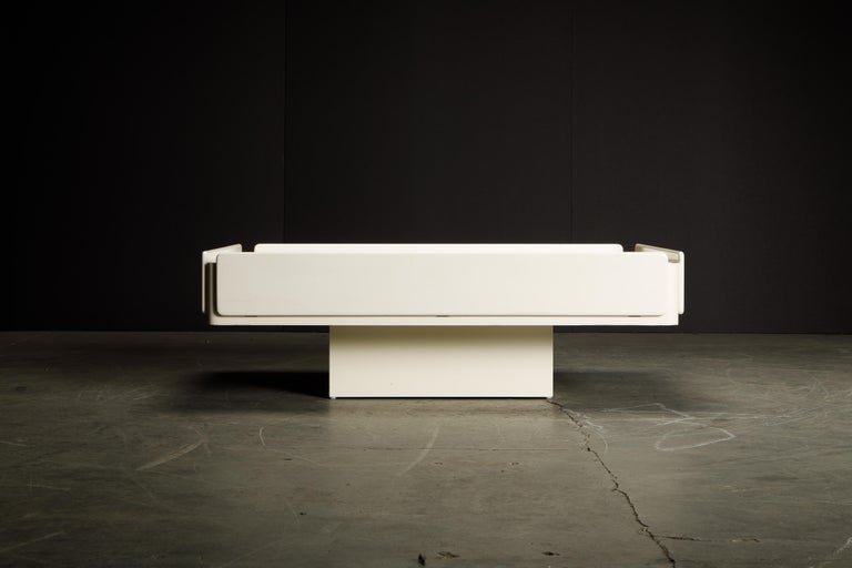 Sleek, cool, functional and elegantly constructed coffee table attributed to the 'Caori' coffee table by Vico Magistretti for Gavina, Italy designed in 1962, in a white lacquered finish with brushed steel top.  This broadly proportioned cocktail