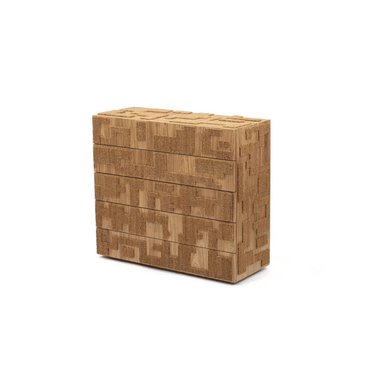 This wooden contemporary chest of drawers is finished with Louro Freijó veneer and coconut fiber mat. This piece is the result of artisanal production process, which makes it extremely unique. Therefore, any irregularities should not be considered