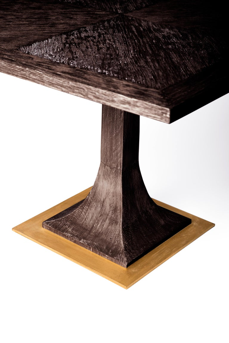 With the use of fine, hand painted rustic wood, the Capistrano dining table evokes the charm of the Spanish influence of the Southern Californian, 1900s. Set on a hand-gilded metal base and single pillar leg, the tabletop features a pattern of
