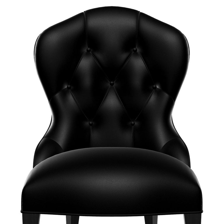 Chair capiton dark with structure in solid mahogany wood, upholstered and covered with high quality grained genuine black leather, with capitonated back seat. With cabriolie feet in black lacquered finish.