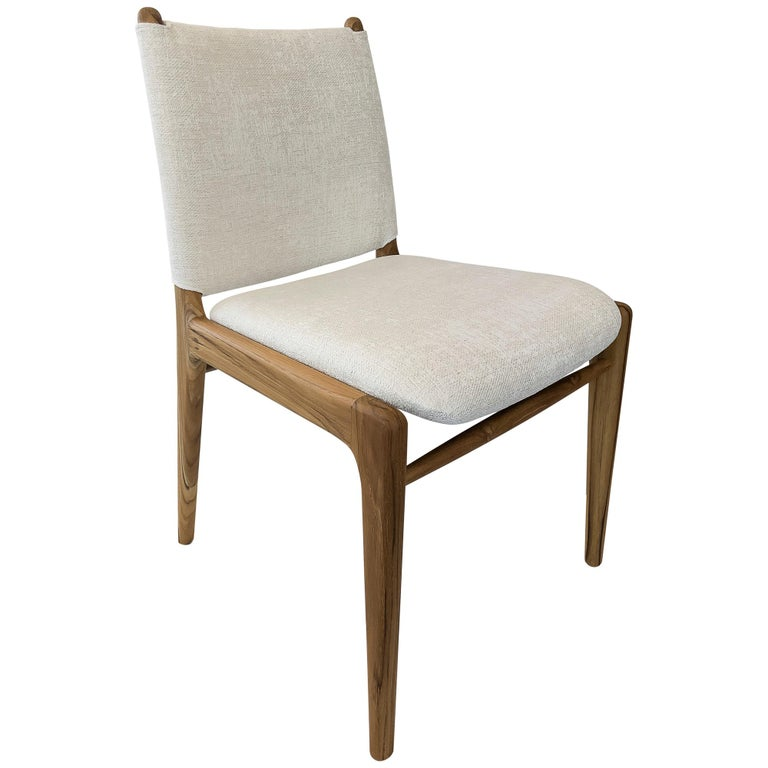 This chair highlights our beautiful walnut finish combined with a stunning cool light fabric and the unique buckle design on the back of the seat.... In stock!