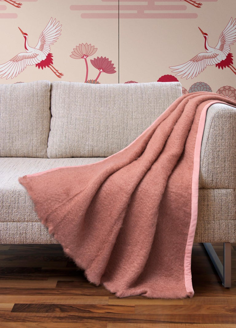 Delicate and elegant, the Capri Mohair Plaid ensures a delicate final touch to any environment. The Capri Mohair Plaid, which comes in pastel pink with cherry blossom pink edges, is naturally soft and warm given its 73% Mohair, 24% Wool, 3%