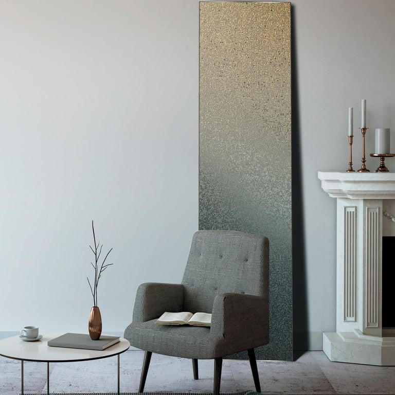 This wall decor is perfect for adding an elegant ambiance to any room of the house. Composed of hundreds of small glass tiles called TILLA picotesserae arranged in a