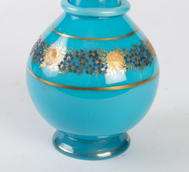 Carafe in turquoise blue opaline, gilded and enameled, Charles X period, 1830-1840  Measures: H 27 cm, D 14 cm.