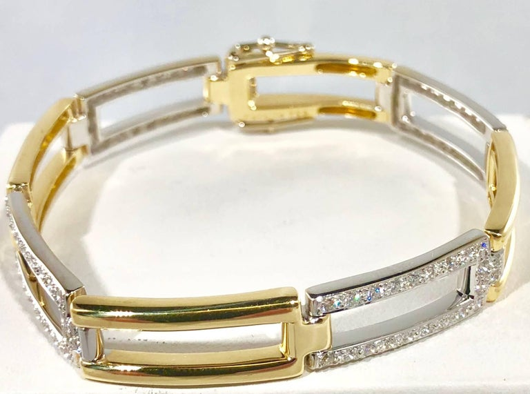 Carelle 18 karat two tone yellow and white gold and diamond bracelet. This piece sparkles with 88 full cut round diamonds equaling 1.73 carats total weight, Color F-G, Clarity VS1. Gold weight is 29.5 grams/ 19.0 dwt. length is 7 inches and 3/8 inch