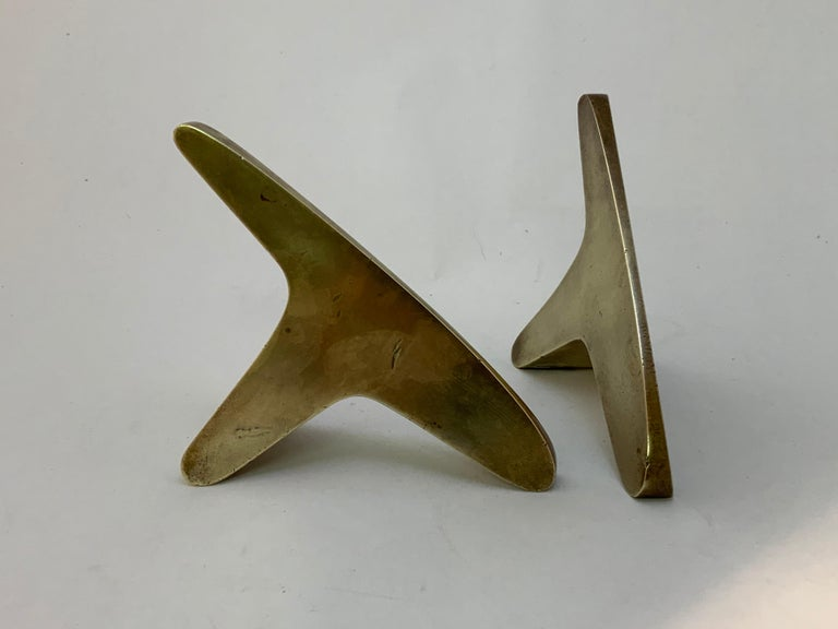 Vintage 1950s solid brass bookends designed by Carl Aubock. Form #3847. Fully signed, Aubock, Made in Austria. Good condition with some light tarnish and wear commensurate with use. Some dings and light scratches (see photos).