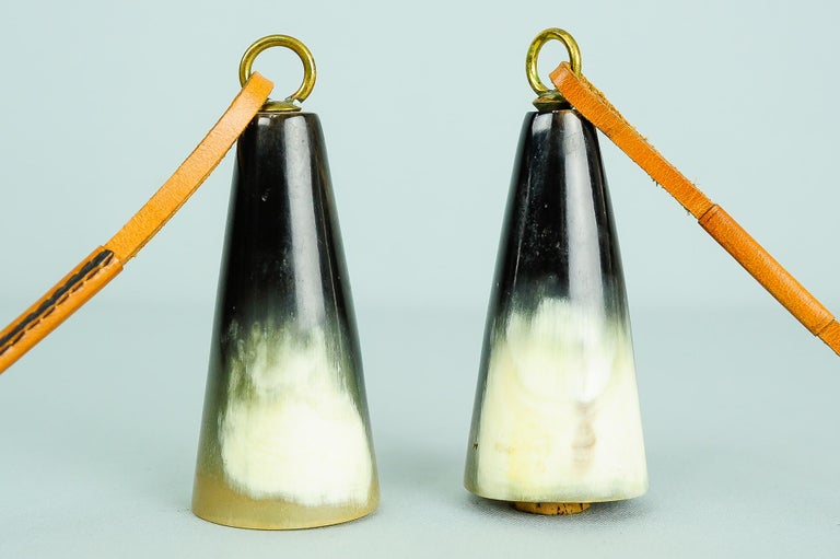 Carl Auböck bottle stopper, Horn, Leather, Austria, 1950s Original condition Price is for both together.