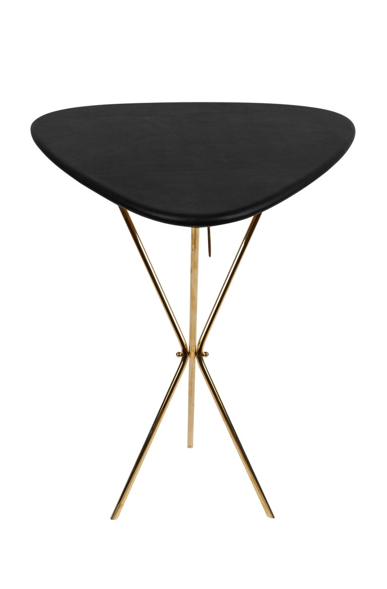 CarlAuböck model #3642 brass and leather table designed in the 1950s, this incredibly refined and sculptural table is executed in beautifully grained oak, polished brass and hand upholstered leather. Inspired by the folding map tables carried by