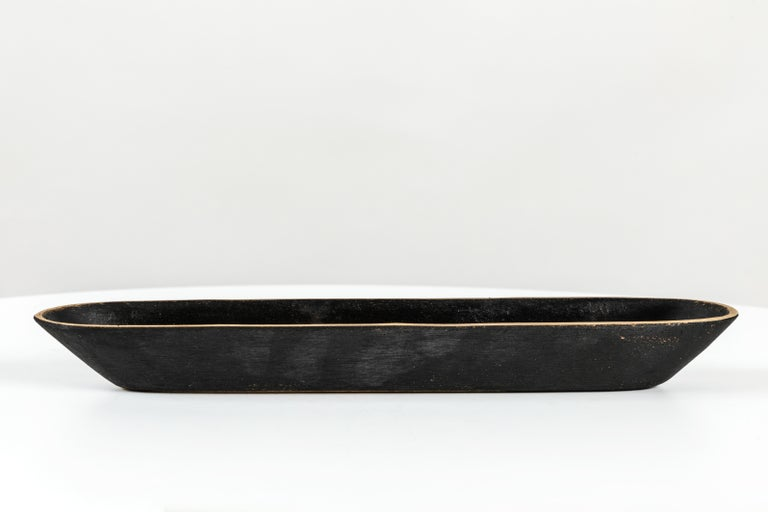 Carl Aubo¨ck Model #4317 Brass Bowl. Designed in the 1950s, this incredibly refined and sculptural Viennese bowl is executed in polished and darkly patinated brass. Originally conceived as a fountain pen holder, this decorative vessel can be used