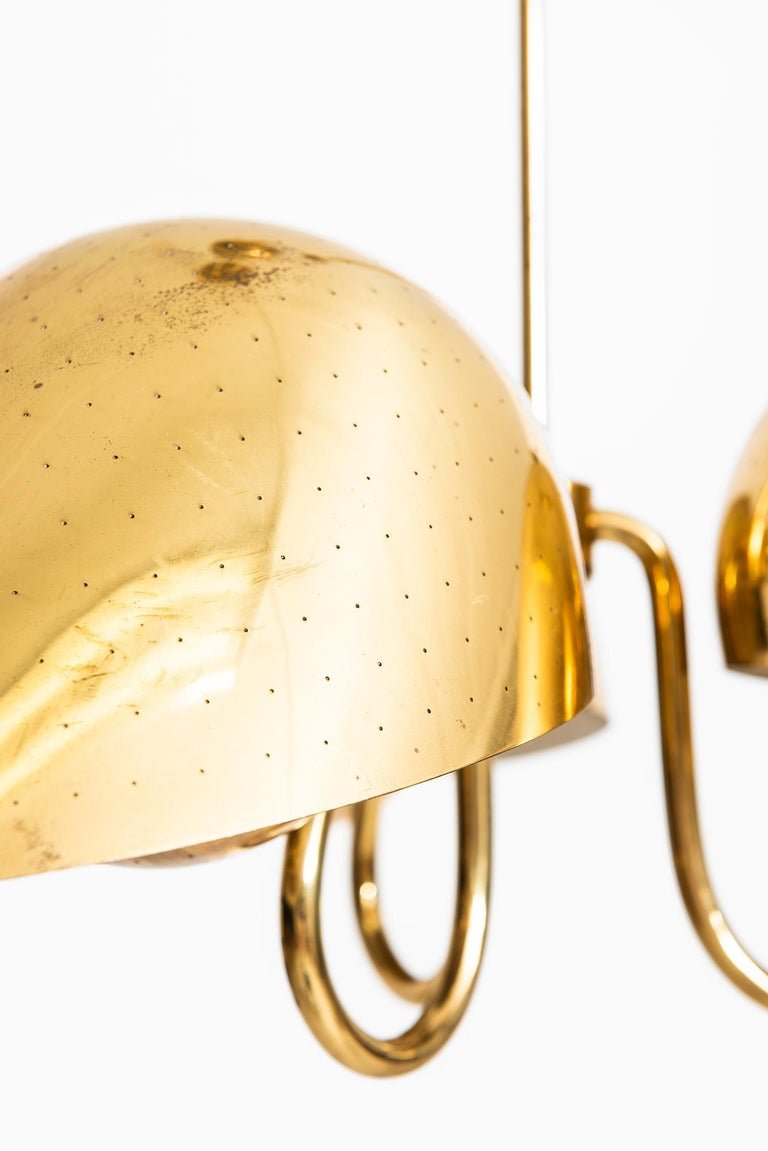 Very rare height adjustable ceiling lamp designed by Carl-Axel Acking. Produced by Bröderna Malmströms Metallvarufabrik in Sweden.