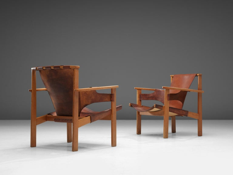 Carl-Axel Acking for Nordiska Kompaniet, 'Trienna' chairs, stained oak, leather, Sweden, 1957