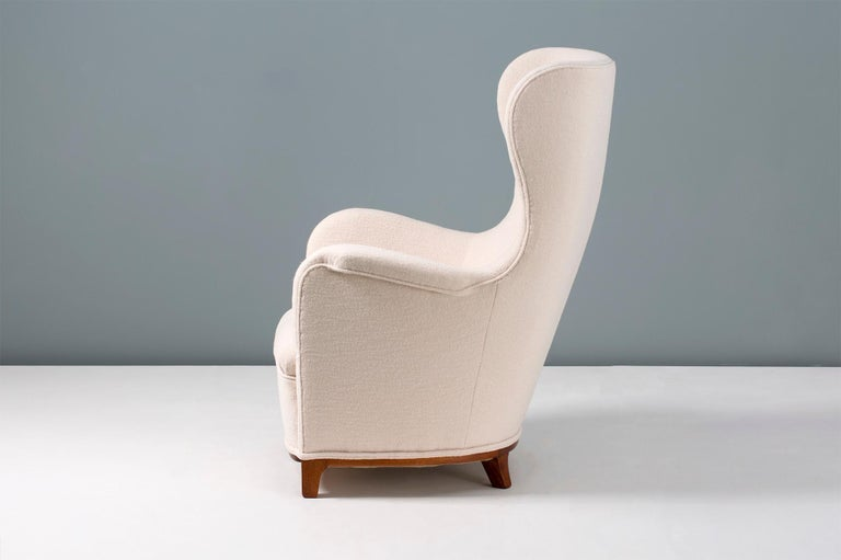 Carl-Axel Acking  Wing chair, 1940s  Rarely seen imposing wing chair from the Pioneer of the Swedish modern movement: Carl-Axel Acking. Cuban mahogany base with new luxurious, pure wool fabric upholstery.