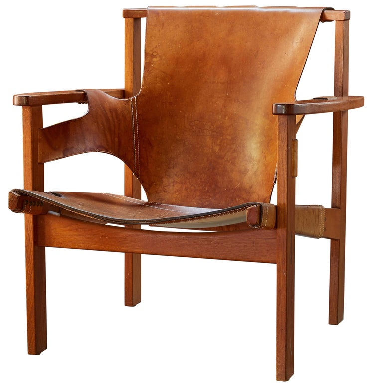 Carl-Axel Acking Trienna chair in patinated brown leather, ca. 1957, offered by Two Enlighten Los Angeles