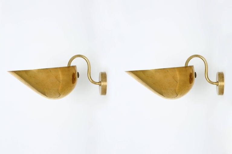 Carl-Axel Acking pair of wall lamps in brass. Large lamps are designed by Swedish architect and furniture maker Carl-Axel Acking. Sweden, 1940. Made with perforated brass.