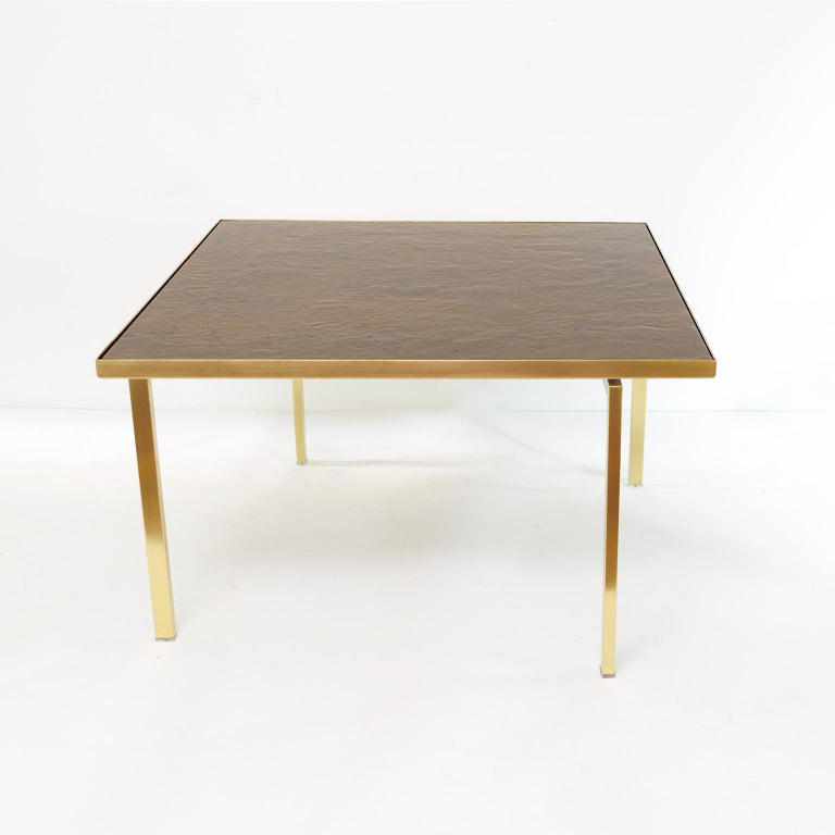 Carl Bjørn and P. Törneman enameled Triva coffee table produced by NK (Nordiska Kopaniet), Stockholm circa 1950's. The all brass frame has been newly polished and lacquered. The surface is enamel on copper and depicts the Bronze Age stone carvings