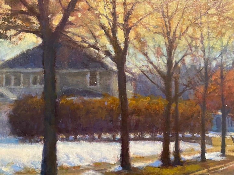 Oil painting of a neighborhood in the winter. A quiet, tree-lined street is sprinkled with snow. A yellow sky blends into blue and above.   Frame dimensions: 32 x 44 inches   Artist Bio Carl Bretzke is a representational painter who specializes in
