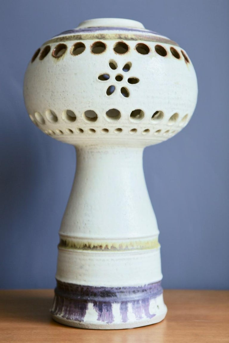 A large and partly pierced stoneware object, decorated in purple and ochre colors, by Carl Cunningham-Cole, manufactured by Kähler in Denmark in the 1960s. Signed to the underside.