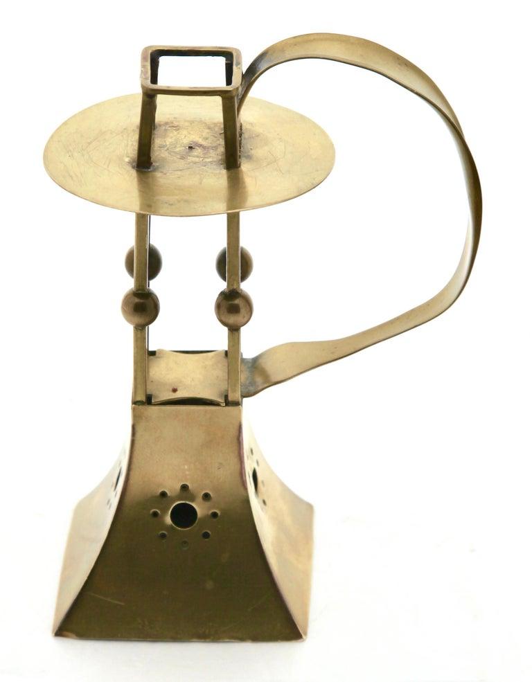 C.D.EWerks of Carl Deffner (1856-1948) of Esslingen,Germany.  Superb Jugendstil copper and brass candle stick by the famous C.D.E Werks of Carl Deffner of Esslingen, Germany. The base, and the upright candle holder is in brass. The square base