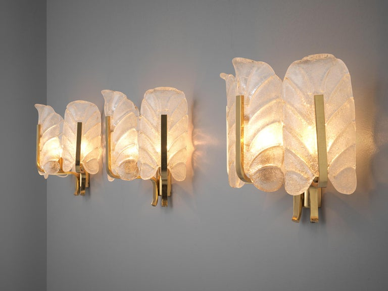 Carl Fagerlund, wall lights, brass, glass, Europe, 1970s  Six elegant wall sconces in structured Murano glass by Carl Fagerlund.Each light consists of three glass shades, all shaped like a structured leaf. Due the structure of the glass and the