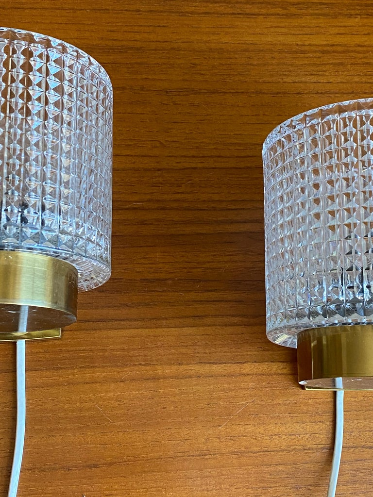 A pair of wall lights / sconces designed by Carl Fagerlund for Orrefors, where he served as a lighting designer from 1946-1980.  In addition to product design for Orrefors and ASEA, Fagerlund served as lighting designer for important commission