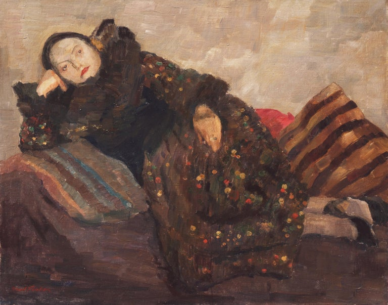"""Signed lower left """"Carl Fischer"""" (Danish, 1887-19520) and painted circa 1945.  A psychologically penetrating oil study of the artist's wife, shown reclining on a chaise-lounge against pillows, supporting her head on her hand and gazing directly"""
