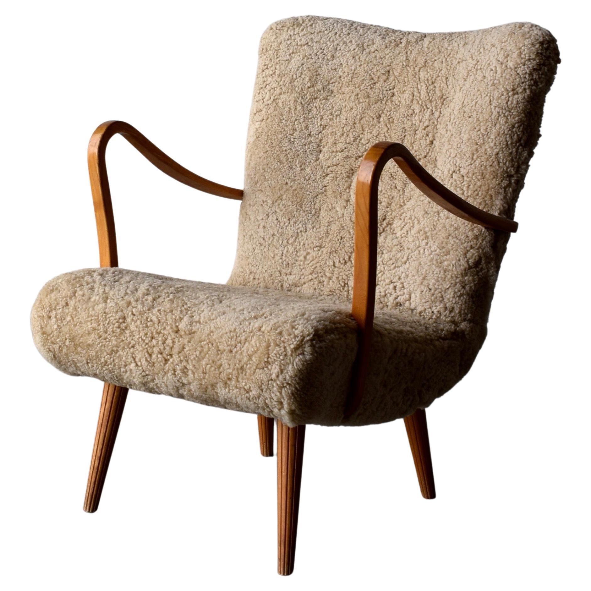 Carl Gustaf Hiort Af Ornäs, Lounge Chair, Wood, Sheepskin, Sweden, 1950s