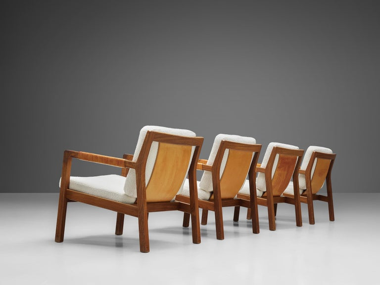 Carl Gustaf Hjort af Örnas for Puunveisto Oy, set of four armchairs, model 'Trienna, teak, leather, textured ivory upholstery, canvas, Finland, 1950s  Set of four easy chairs, designed by Carl Gustaf Hjort in the 1950s. The chairs display an