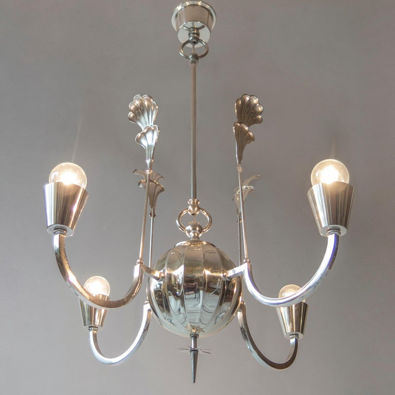 Design attributed to the iconic Swedish lighting designer Elis Bergh and expertly crafted by the preeminent Swedish metalworker C.G. Hallberg. The tapering canopy, above ring fasteners and a central hanging rod, the scalloped and spherical body