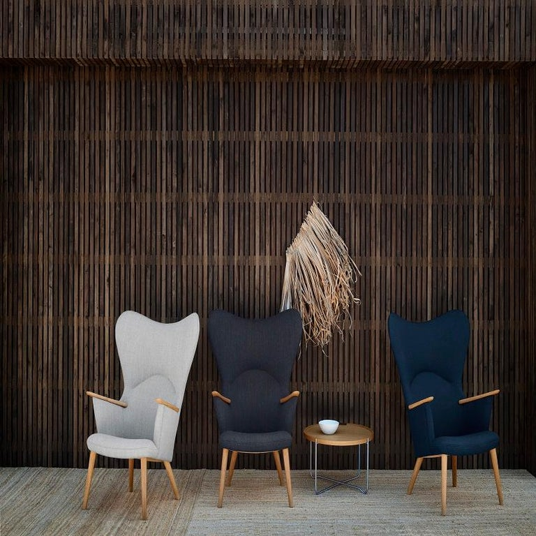 Affectionately known as the Mama Bear chair, the CH78 lounge chair was originally introduced in 1954, and was an extension of Wegner's CH71 'Mini Bear' Chair (1952) design. Defined by a series of inviting curves that offer up a warm embrace, the