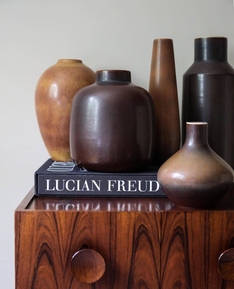 A decorative collection of five ceramic vessels by two of the most celebrated Swedish 20th century ceramists Carl-Harry Stålhane & Gunnar Nylund, in brown color tones and various shapes.  Manufactured by Rörstrand Ab, Sweden, circa