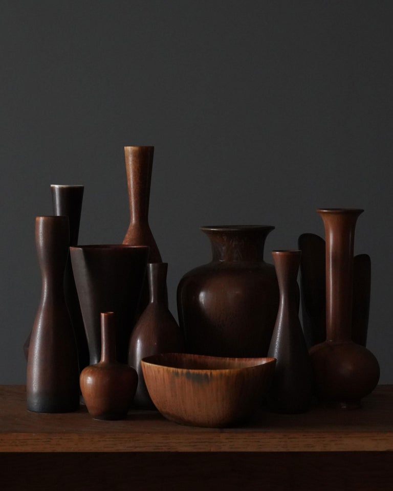 An assorted collection of 11 vases and bowls executed in stoneware and produced by Rörstrands, Sweden, 1940s. Three designed by Gunnar Nylund, and the rest by Carl-Harry Stålhane. All vases with highly artistic glazes and colors include brown,