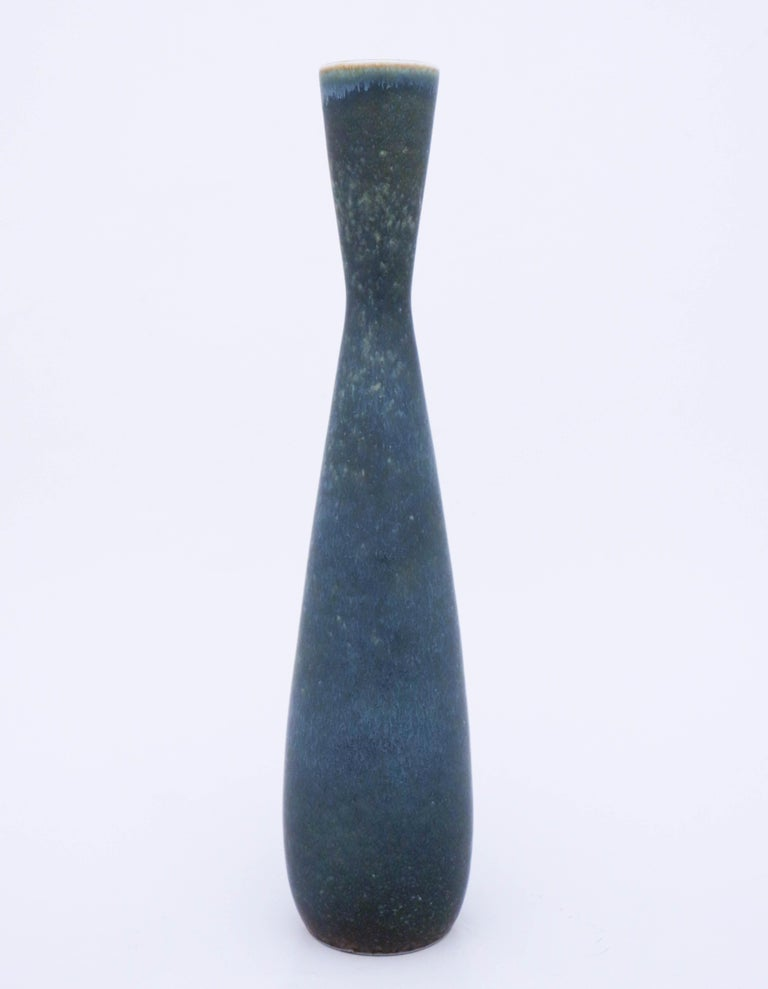 A beautiful midcentury Swedish vase in stoneware by Rörstrand, designed by Carl-Harry Stålhane. This large and unique vase was produced in 1960, it is marked as 2nd quality and do have a white mark in the glaze.