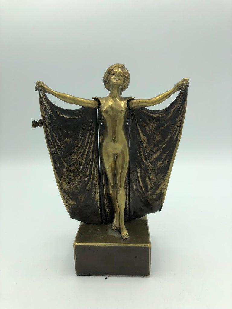 Carl Kauba Figurative Sculpture - Open Sesame (Mechanical Bronze)