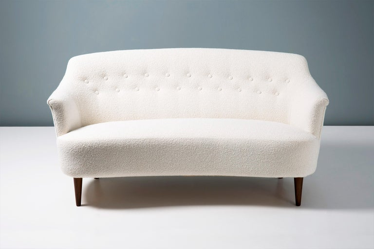 This exceptional piece of Swedish furniture was designed in the 1940s by master cabinetmaker and designer Carl Malmsten. It was produced at his own workshop near Stockholm in Sweden. This example has been reupholstered in luxurious cotton-wool blend