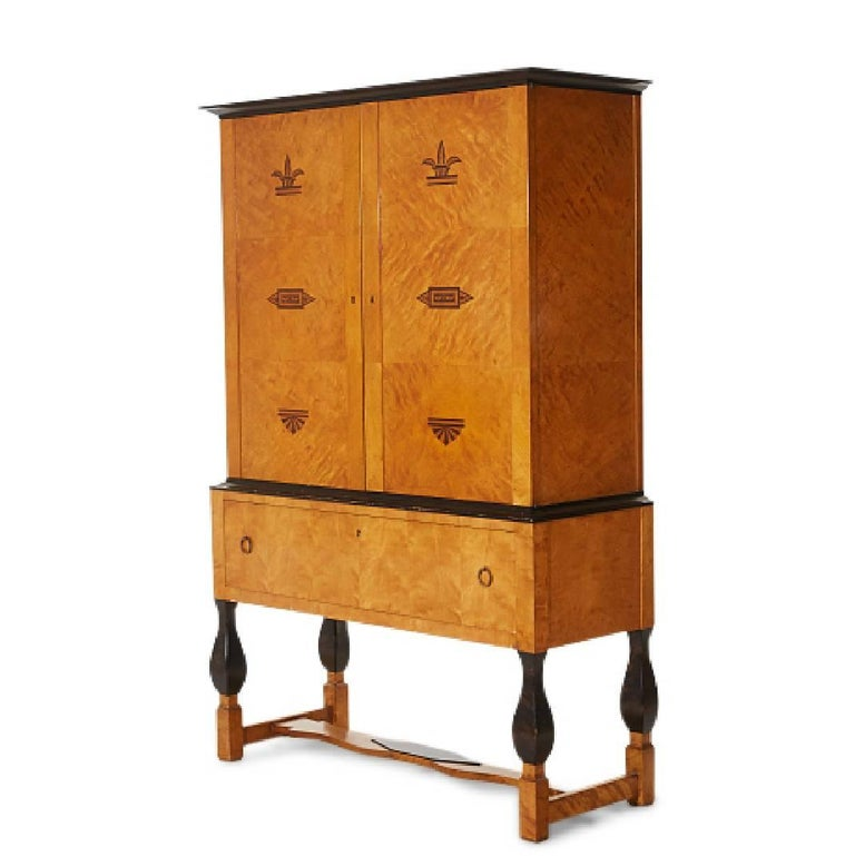"""Cabinet from the """"Haga"""" collection in birch with black intarsia decorations. Design by Carl Malmsten for Nordiska Kompaniet. Made in the 1920s.  Dimensions: height 190, W126 x D48. Nordiska Kompaniet metal plate certifying the origin of manufacture."""