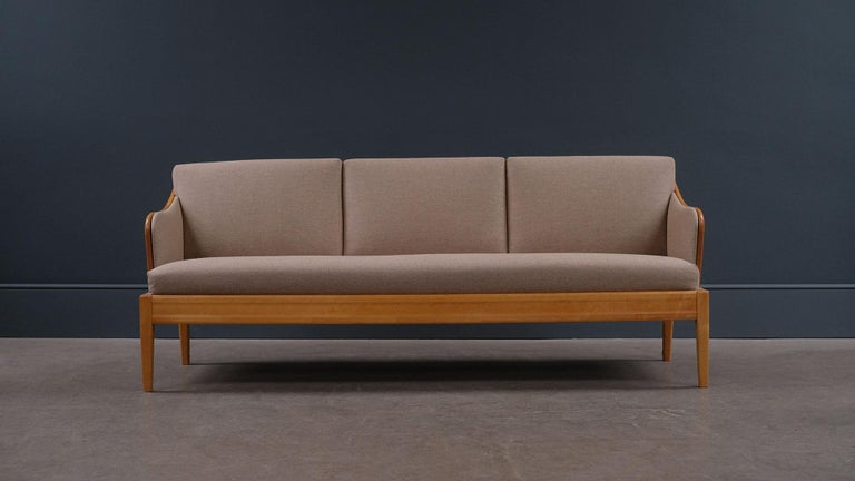 Super elegant sofa designed by Carl Malmsten, 1940s, Sweden. Lovely Birch wood frame with nice grain and warm patina. Fully refurbished and reupholstered seats. Comfortable sofa and fully sprung mattress make it useable as a daybed.