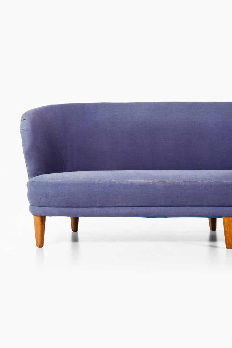 Rare and large version of the sofa model Berlin designed by Carl Malmsten. Produced by Carl Malmsten in Sweden.