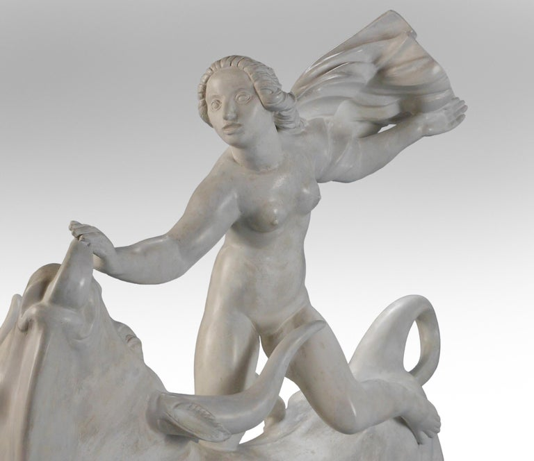 Carl Milles, Rare Plaster Sculpture of Europa and the Bull, circa 1925 Kneeling astride the vigorous bull, Europa is poised in flight, her cloak blowing in the wind, raised on a rectangular contoured base with foliate frieze. Europa and the Bull