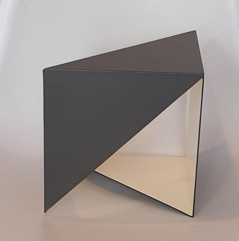 Steel 67 is a unique small size contemporary modern abstract sculpture by Dutch artist Carl Möller. This work explores the effect of adding and deleting diagonal planes in a perfect steel cube of 20x20x20 cm. In doing so, the artist creates open