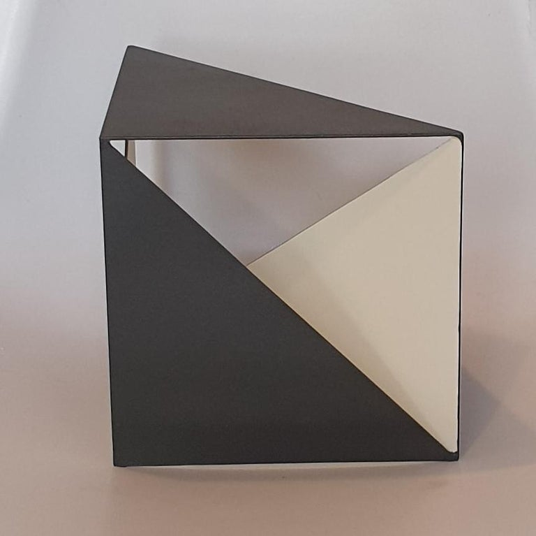 Steel 68 is a unique small size contemporary modern abstract sculpture by Dutch artist Carl Möller. This work explores the effect of adding and deleting diagonal planes in a perfect steel cube of 20x20x20 cm. In doing so, the artist creates open