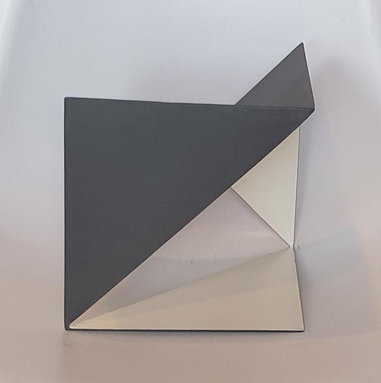 Steel 74 is a unique small size contemporary modern abstract sculpture by Dutch artist Carl Möller. This work explores the effect of adding and deleting diagonal planes in a perfect steel cube of 20x20x20 cm. In doing so, the artist creates open