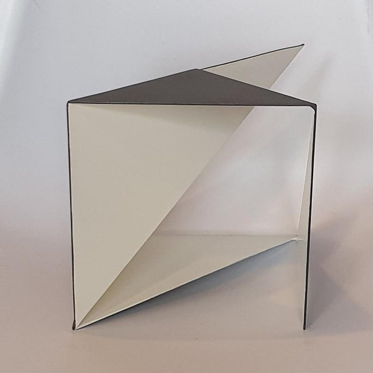 Steel 76 is a unique small size contemporary modern abstract sculpture by Dutch artist Carl Möller. This work explores the effect of adding and deleting diagonal planes in a perfect steel cube of 20x20x20 cm. In doing so, the artist creates open